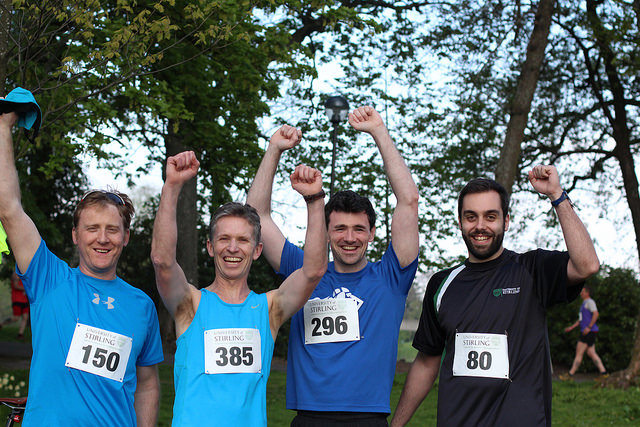 Runners celebrating completing their race